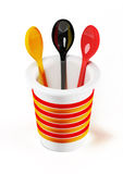 3d plastic cup with spoons isolated on white Royalty Free Stock Image