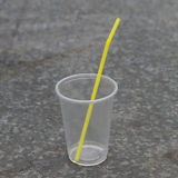Plastic cup with straw. Used empty plastic cup with straw stock photography