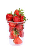 Plastic cup with strawberries on white Stock Photo