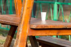 Plastic cup on the table. In the park in nature stock photography
