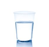 Plastic cup with water, concept of nutrition and diet. Plastic cup with water on white background, concept of nutrition and diet stock image