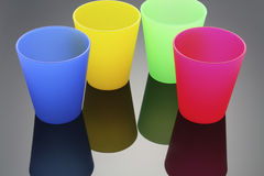 Plastic Cups. Color Plastic Cups with Reflection Royalty Free Stock Images