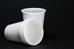 Plastic cups. White plastic cups on black background Royalty Free Stock Photo