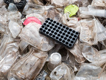 Plastic cups and containers prepared for recycling Stock Photo