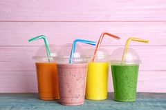 Plastic cups with delicious detox smoothie stock photography
