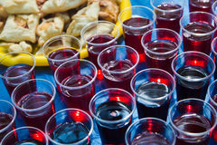 Plastic cups with juice Royalty Free Stock Photography