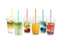 Plastic cups with lemonades. On white background stock photos