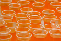 Plastic cups with orange drink Royalty Free Stock Photography