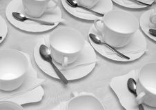 Plastic cups and saucers with spoons. On a table Stock Photo