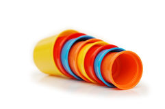 Plastic cups of various colours. Isolated on white royalty free stock photography