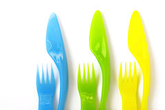 Plastic Cutlery. Colorful plastic forks and knifes, suitable to children's meals Stock Photo