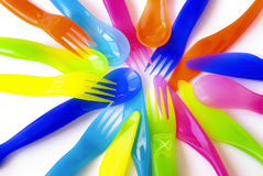 Plastic Cutlery. Colorful plastic spoons, forks and knifes, suitable to children's meals Royalty Free Stock Image