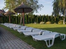 Plastic deck chair in the garden. Plastic deck chair in the gren garden Stock Photography