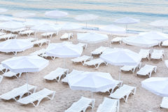 Plastic deck chairs on a sunny beach in Bulgaria Royalty Free Stock Photo