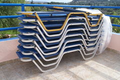 Plastic deckchairs. stacks of sunbeds Stock Images