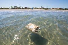 Plastic Deposit In Ocean Next To Beach Royalty Free Stock Photo