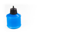 Plastic die lijmcontainer op wit wordt geïsoleerd Stock Foto's