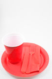 Plastic Dinner Ware. Red disposable plastic dinnerware /picnicware Royalty Free Stock Photography