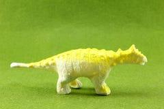 Plastic Dinosaurs. Plastic dinosaur on green background Stock Photography