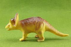 Plastic Dinosaurs. Plastic dinosaur on green background Stock Image