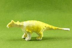 Plastic Dinosaurs. Plastic dinosaur on green background Royalty Free Stock Image