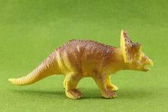 Plastic Dinosaurs. Plastic dinosaur on green background Royalty Free Stock Photography