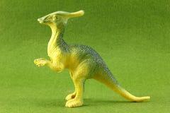 Plastic Dinosaurs. Plastic dinosaur on green background Stock Photo
