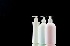 Plastic dispenser with liquid soap on a black background. Royalty Free Stock Images