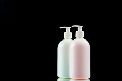 Plastic dispenser with liquid soap on a black background. Royalty Free Stock Photo