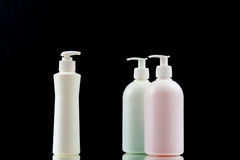Plastic dispenser with liquid soap on a black background. Royalty Free Stock Image