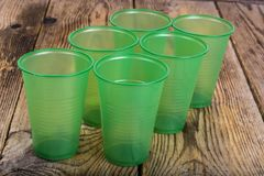 Free Plastic Disposable Tableware On Wooden Table Royalty Free Stock Photos - 109413058