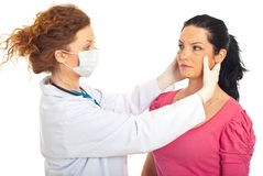 Plastic doctor prepare woman for surgery Stock Image