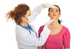 Plastic doctor and woman prepare for surgery Stock Photos