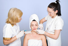 Plastic doctors giving botox shot Royalty Free Stock Images