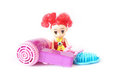 Plastic doll , comb and hair dryer toy Stock Photo