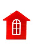Plastic doll`s house. A red doll`s house made of plastic details for designing   isolated on white background Stock Photos