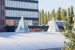 Dome op an roof. Plastic Dome in a row on a metal roof stock photo