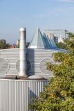 Dome op an roof. Plastic Dome in a row on a metal roof royalty free stock photography
