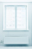 Plastic double door window with radiator under it. Royalty Free Stock Images
