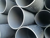 Plastic drain pipes pvc in a pile. Plastic drain pipes in a pile in the store, industry, industrial, tubes, pvc Royalty Free Stock Photography
