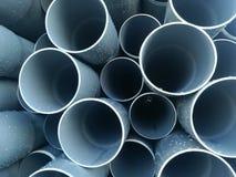 Plastic drain pipes pvc in a pile. Plastic drain pipes in a pile in the store, industry, industrial, tubes, pvc Stock Photo
