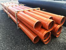 Plastic drain pipes pvc in a pile. Plastic drain pipes in a pile in the store, industry, industrial, tubes, pvc Royalty Free Stock Photos