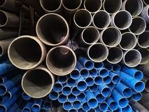 Plastic drain pipes pvc in a pile. Plastic drain pipes in a pile in the store, industry, industrial, tubes, pvc Stock Photography