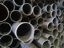 Plastic drain pipes pvc in a pile. Plastic drain pipes in a pile in the store, industry, industrial, tubes, pvc Stock Images
