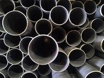 Plastic drain pipes pvc in a pile. Plastic drain pipes in a pile in the store, industry, industrial, tubes, pvc Stock Image
