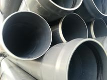 Plastic drain pipes pvc in a pile stock photo