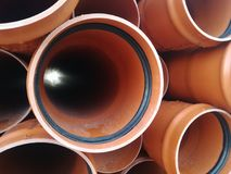 Plastic drain pipes pvc in a pile. Plastic drain pipes in a pile in the store, industry, industrial, tubes, pvc Royalty Free Stock Photo