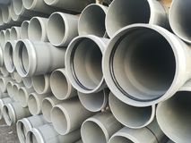 Plastic drain pipes pvc in a pile. Plastic drain pipes in a pile in the store, industry, industrial, tubes, pvc Stock Images