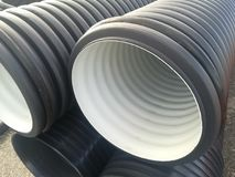 Plastic drain pipes pvc in a pile. Plastic drain pipes in a pile in the store, industry, industrial, tubes, pvc Royalty Free Stock Image