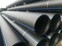 A pile of Plastics pipes. Plastic drain pvc pipes, industrial, industry, pipeline stock photo